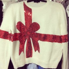 Present sweater with red sequin bow