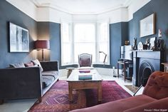 Deep blues and maroon hues make this living room the perfect place to start the week off in! Shot by @elliotwalsh, take the tour of @mad_about_the_house's sumptuous home with the link in our bio ⬆#interiors #bloggers #victorianhome #navy #darkcolours #livingroom #victorianfireplace #ukinteriors #homedecor #houzzuk