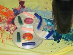 """CD Melted Crayon Art from this week's """"Abstractions"""" Teen Art Program."""