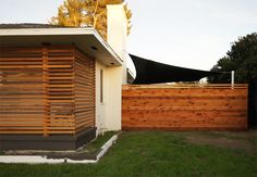 Slat-screen + fence + amazing sail shade = top diy project priority