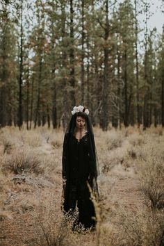 Enchanted Halloween wedding inspiration, black wedding dress and veil