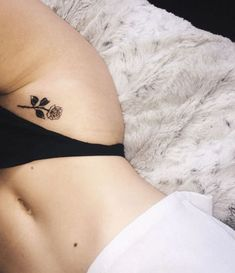 Rose Small Tattoo Between Thigh and Belly