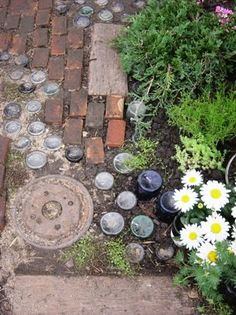 Look! :  Recycled Garden path. love the use of upside down bottles and the crazy art factor.