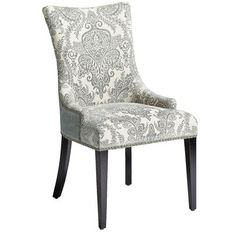 Our Adelle Dining Chair packs a powerful one-two punch. Adorning the front is a beautiful damask pattern, and the back features a bold, single-color look. Accentuated with antique brass nailhead trim and supported by a sturdy birch frame and tapered legs, it's a classic contemporary knockout.