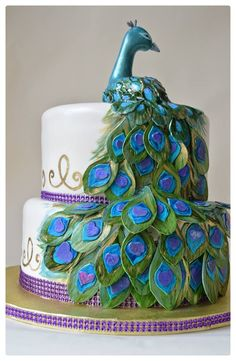 Peacock wedding cake. Looking for that perfect custom cake? Ask Mona at Bake Me Something. You can contact her at (510) 299-0766 or mona.marwaha@gmail.com #weddingcake