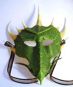 Dragon Mask - inspired the idea to use a green baseball cap to make a dragon head with fire off front, eyes and horns for party hats.