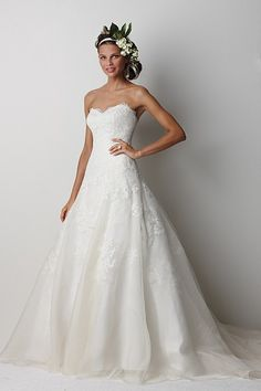 The perfect white dress. It's a sweet heart neck line with lace.