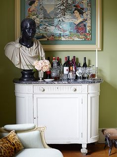 "A perfectly Sheila vignette: A framed piece of outsider art hangs above a classical bust on the bar. See more of this gorgeous New York City apartment in ""Inside Designer Sheila Bridgess Ravishing Home in Harlem"" on the One Kings Lane Style Guide. Cute Dorm Rooms, Cool Rooms, Old Wooden Boxes, Bungalow Interiors, Interior Design Advice, Interior Ideas, Farmhouse Side Table, Small Furniture, White Furniture"