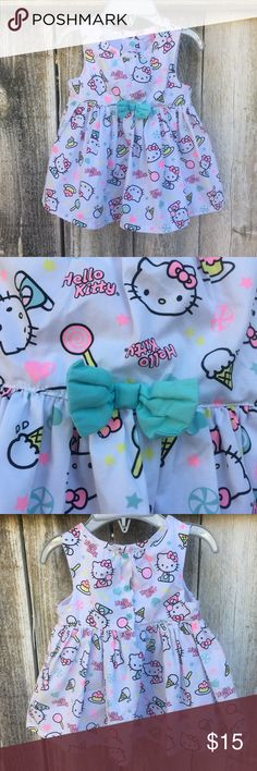 Hello Kitty Sweets Dress Like New 🍰🍭  White dress with turquoise underwear. Perfect for Spring! Fabric design has Hello Kitty with lollipops and cupcakes throughout.   Bundle for additional savings! Hello Kitty Dresses Casual