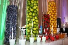 Decorative glass cylinders at the smoothie bar were filled with fruit that complemented the blue, green, red, and yellow accents...