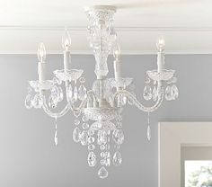 Bella Flushmount Chandelier  from Pottery Barn-1 between the kitchen and parlor and 2 small chandeliers over the kitchen counter too. There is a regular (non-flushmount) version for over kitchen counter.