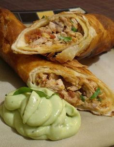 Flautas De Pollo With Avocado Cream from Food.com: This is my favorite Mexican dish. I have been searching for a recipe for years but all fell short. Then one Saturday morning i saw this on cooking for real with Sunny Anderson. It's just pure heaven It got it's name because of it's long thin shape. Flauta is Spanish for Flute
