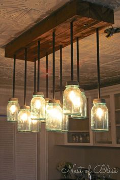 It Wednesday No. 24 LOVE this tutorial! Build it: DIY Mason Jar Chandelier from Nest of Bliss! Build it: DIY Mason Jar Chandelier from Nest of Bliss! Mason Jar Chandelier, Mason Jar Lighting, Mason Jar Lamp, Jar Candle, Chandelier Wedding, Chandelier Ideas, Diy Mason Jar Lights, Mason Jar Light Fixture, Chandeliers