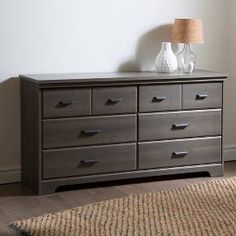 Bring rustic charm to your bedroom decor with the Versa 6-Drawer Double Dresser from South Shore. This dresser stands a little over 31 inches high, giving you plenty of storage across six side-by-side drawers, as well as ample surface space to stash accessories, decorative accents or a lamp. Create a cohesive look in your bedroom decor by pairing this dresser with other pieces from the Versa collection from South Shore.