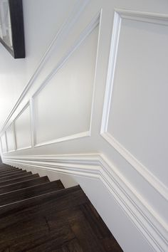 Beautiful wall panel wainscoting down a starwell. Perfect for a Hamptons, Edwardian or Georgian style home. Stair Paneling, Wainscoting Stairs, Wall Panelling, Georgian Interiors, Georgian Homes, Georgian Residence, Timber Mouldings, Moldings And Trim, Panel Moulding