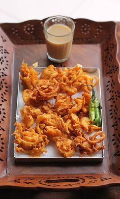 Onion Pakora is a popular Mumbai street food.  I love onion pakoras hot with a cup of tea during monsoon, what about you?  http://www.flavorsofmumbai.com/onion-pakora-recipe/