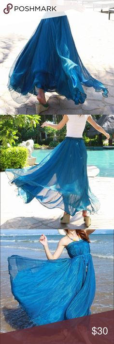 "Blue Chiffon Maxi Flowy Skirt A lovely blue long flowing skirt. Great for twirling! Chiffon. The waistband is elastic. Waist: 23.62""-39.37"", length: 35.43"" Skirts Maxi"
