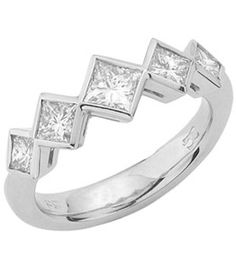 18ct White Gold Diamond Ring.     5 princess cut diamonds in rub over settings on a solid knife edged band.       Centre diamond from 0.25ct.