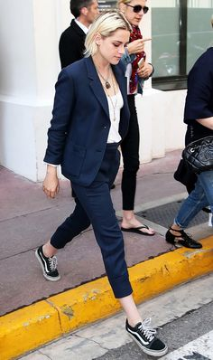 Tomboy style maven Kristen Stewart illustrates how sneakers are a cool and easy shoe choice when wearing a suit.
