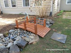 DIY Backyard Makeover on a Budget from Pink and Green Mama Blog- dry river bed bridge and fun kid outdoor space ideas