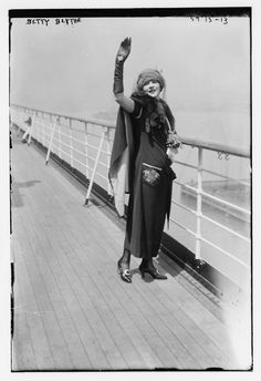 Actress Betty Blythe standing on a ship deck, waving , C. 1920