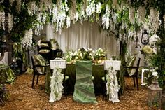 The arch with hanging flowers or golden leaves for main table or katb ketab table