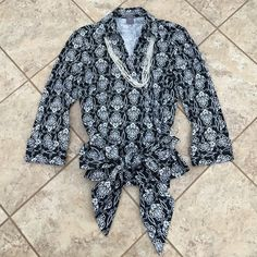 Ann Taylor Wrap Blouse Trendy yet classic. Wraps and ties in front. 96% cotton, 4% lycra. Great with black pants or skirt! Ann Taylor Tops Blouses