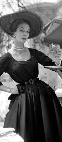 Dress by Dior, 1950s. You can see that this model has worked hard at corset training her waist.