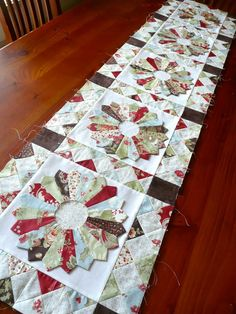 You may remember my Mum's table runner  that she has been working on? The pattern is called ' Plates for your Table ' by Kim Walus at bitty ...