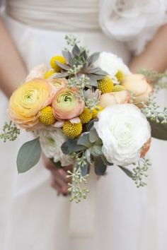 The bridal bouquet will be a naturally-shaped, textural bouquet of ivory garden roses, peachy-yellow ranunculus, yellow craspedia, gray succulents, gray dusty miller, green rosemary and green seeded euchalyptus wrapped in frayed ivory linen with the stems showing.
