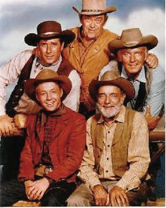 "One of the early casts on TVs ""Wagon Train"".....Back row L-R- Robert Fuller, John McIntire, Terry Wilson. Front row L-R - Michael Burns, Frank McGrath -- Wagon Train ran from 1957-1965"