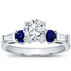 Simply stunning- royal blue Sapphire accents w/ diamond baguettes.