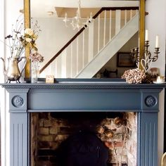 Farrow and ball Downpipe Fire surround by Emma Connolly.