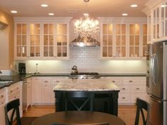 I like these cabinets, glass cabinets probly help keep the room from seeming smaller with lots of cabinets