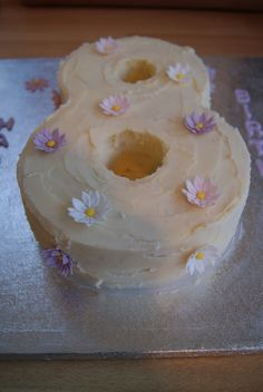 A lovely gluten free victoria sponge cake with pastel flowers