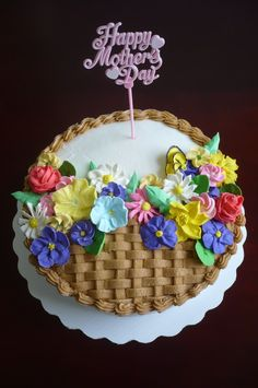 Mother's Day Cake - Fudge chocolate cake covered with buttercream.  All flowers are done in royal icing.