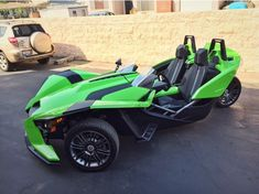ITS GREEN! This is my favorite Polaris Slingshot wrap that I've seen. There are more photos of this, if you click through.