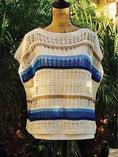 Create a layered look with this pretty Chart Topper! Instructions are written for sizes S (M, L, XL, 2XL, 3XL). Model shown was made using 5 colors of Omega Eulali.