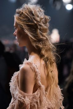 Most epic hair goes to Alexander McQueen thanks to Guido Palau, who dreamed up the messiest, most ornate bohemian plaits we've ever seen. Inspired by slept-in hair, it still boasts some serious artistry, with Palau literally using a needle and thread to achieve a sewing-like ruched texture.