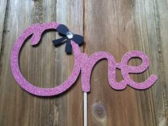 Items similar to First birthday Cake topper - birthday - Girl birthday - Glitter hot pink and black - One - party decor - centrepiece on Etsy Custom Wedding Cake Toppers, Wedding Cakes, First Birthday Cake Topper, 1st Birthday Girls, Centerpiece Decorations, First Birthdays, Hot Pink, Unique Jewelry, Handmade Gifts