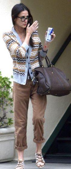 Who made Demi Moore's brown handbag? Purse – Yves Saint Laurent  Sweater – Tory Burch