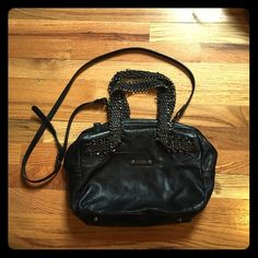 Guess Luxe Genuine Leather Handbag Gently used crossbody. Genuine leather is in perfect condition! Adjustable crossbody strap. Slight imperfections shown in photos 3 & 4; slight tarnish on black hardware, handle fabric coming loose and inner seam is ripped. Open to an offer! Guess Bags