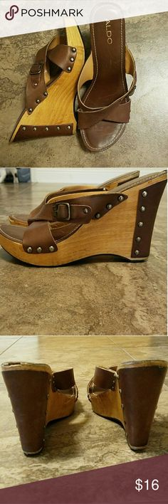 Aldo wooden wedges Strapy sandals with wedge and platform! In good condition small chip by the toe (will add pic soon) not very noticeable! You can actually see it in second picture but will add close up soon Aldo Shoes Wedges