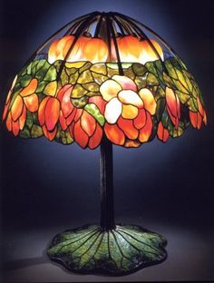 A highly important leaded Glass bronze and mosaic LOTUS lamp, Tiffany Studios , c. 1900-1910. This lamp appeared in Christies December 1997 auction. It sold for a record $2,807,500.
