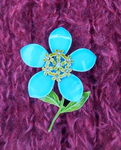 Mod mid century flower brooch, sky blue and green enamel, raised center with little daisies and rhinestone centers, 1960's-'70's era by ClassicCrow on Etsy