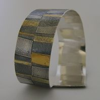 Seamed Stripe Cuff uses gold and silver fused together to get a quite amazing effect