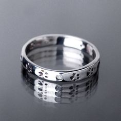 Etsy - Dog Paw Print Ring Made Of Fine Silver- Dog Lover Jewelry- PMC And Cubic Zirconia Stacking Ring- Size 7 1/2 - $37.01