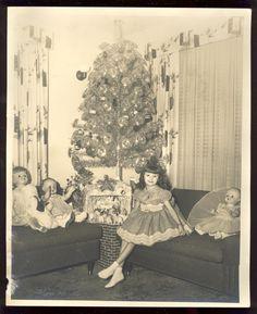 Vintage Christmas photo, aluminum tree, dolls, nativity scene with a lot of sheep.