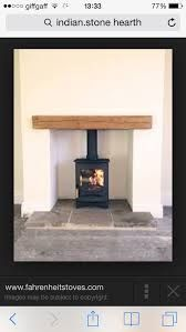 C-Four, oak fireplace beam, reclaimed Yorkshire stone hearth.Charnwood C-Four, oak fireplace beam, reclaimed Yorkshire stone hearth. Wood Burner Fireplace, Small Fireplace, Fireplace Hearth, Wood Mantle, Floating Fireplace, Cottage Fireplace, Fireplace Shelves, Fireplace Outdoor, Shiplap Fireplace