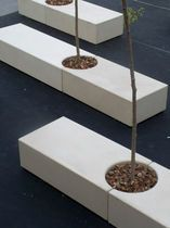 Contemporary public bench in concrete with integrated planter